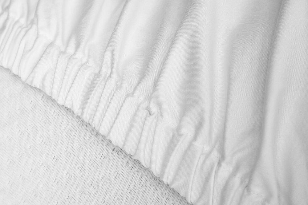 Nord Sateng sengetøy formsydd laken bise god strikk kvalitet klassisk norsk design hvit